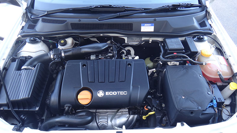 Showing a car engine, bonnet open